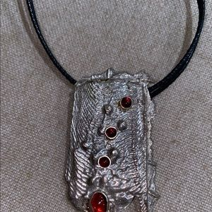 Rectangular designed necklace with pendent